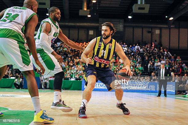 Linas Kleiza of Fenerbahce Ulker Istanbul tries to get to the basket against Will Daniels and Ali Traore of JSF Nanterre during the game between JSF...