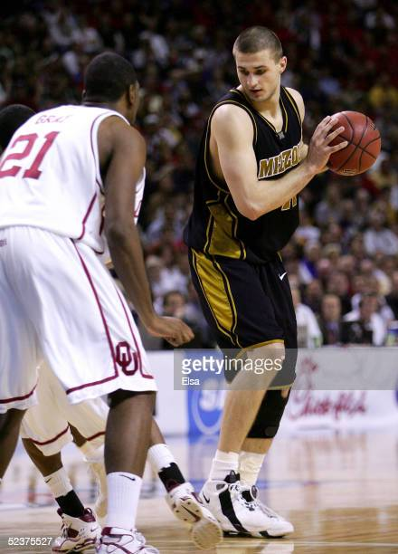 Linas Kleiza of the Missouri Tigers looks to drive on Taj Gray of the Oklahoma Sooners in Day 2 of the Phillips 66 Big 12 Men's Basketball Tournament...