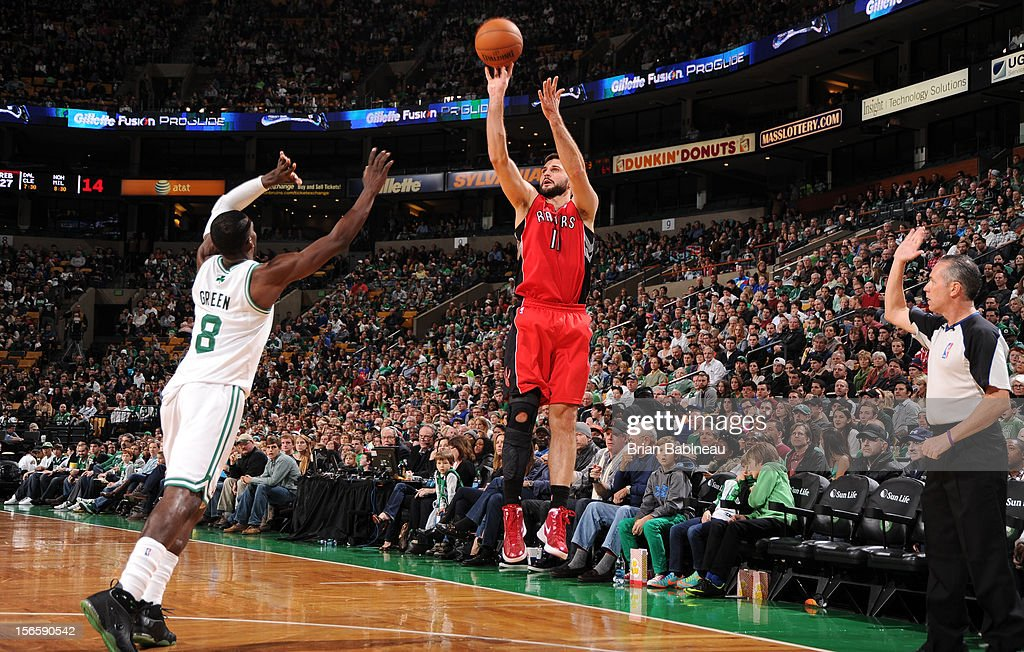 Linas Kleiza #11 of the Toronto Raptors takes a shot over Jeff Green #8 of the Boston Celtics on November 17, 2012 at the TD Garden in Boston, Massachusetts.