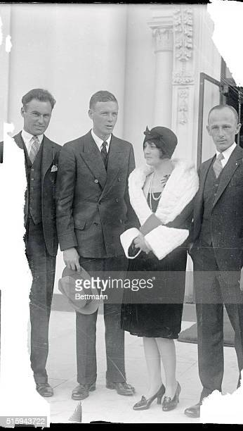 Linbergh with Ruth Elder and flyers group outside White house after luncheon with President Coolidge.