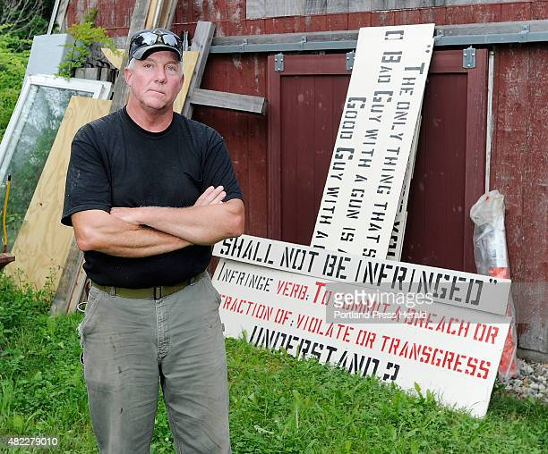 Linc Sample, author of controversial signs about guaranteed rights in the constitution, stands with his next sign he will put up tomorrow, according...