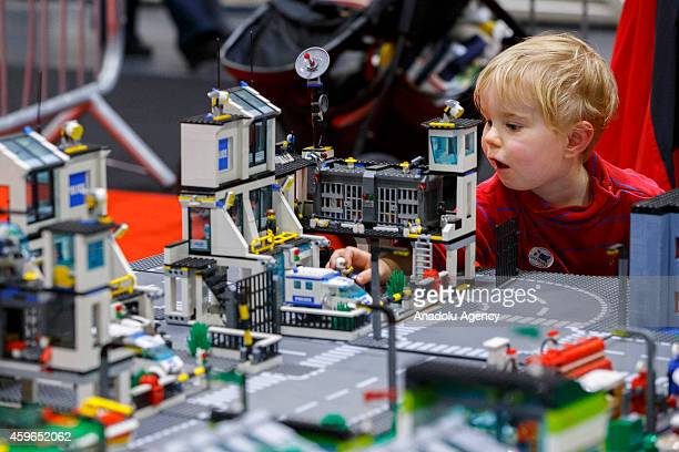Lincoln Baraka plays with a 10 x 3 metres Lego city on the opening day of the Lego show 'Brick 2014' at Excel Centre in east London England on...