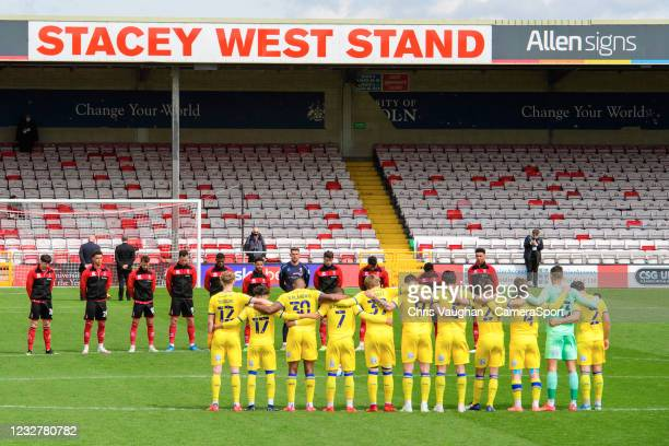 Lincoln City and AFC Wimbledon players observe a minutes silence to remember the those affected by the 1985 Bradford Fire prior to the Sky Bet League...