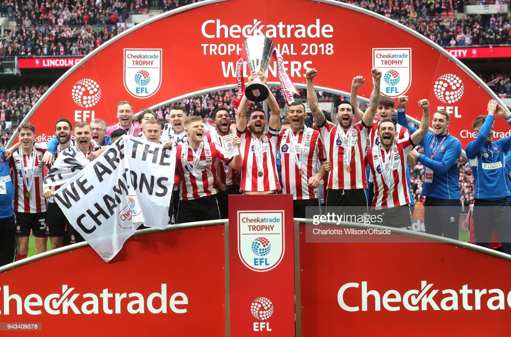 Lincoln City celebrate winning the Checkatrade Trophy during the Checkatrade Trophy Final between Lincoln City and Shrewsbury Town at Wembley Stadium on April 8, 2018 in London, England.