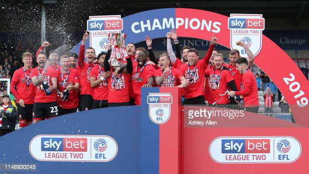 Lincoln City celebrate with the trophy during the Sky Bet League Two match between Lincoln City and Colchester United at Sincil Bank Stadium on May...