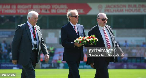 Lincoln City chairman Bob Dorrian centre is joined by Former Imps Players Association chairman Trevor Swinburne left and chairman of the Red Imps...