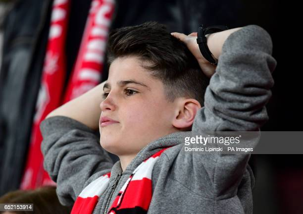 A Lincoln City fan in the stands looks dejected during the Emirates FA Cup quarter final at The Emirates Stadium London