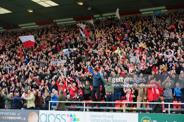 Lincoln City fans celebrate their teams first goal scored by Lincoln City's Tyler Walker during the Sky Bet League One match between Lincoln City and...