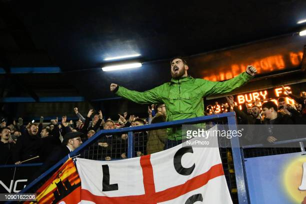 Lincoln City fans celebrate their teams third goal during the Sky Bet League 2 match between Bury and Lincoln City at Gigg Lane Bury on Saturday 26th...
