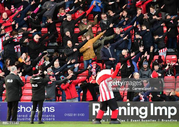 Lincoln City fans #dab4Daniel in tribute to Daniel Harris who died before Christmas prior to the Sky Bet League Two match between Lincoln City and...