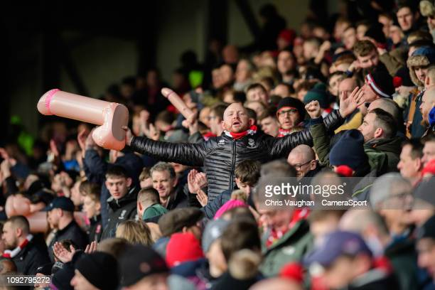 Lincoln City fans hold aloft inflatable penis, raising money for Prostate Cancer UK, in the wake of Notts County chairman and owner Alan Hardy...