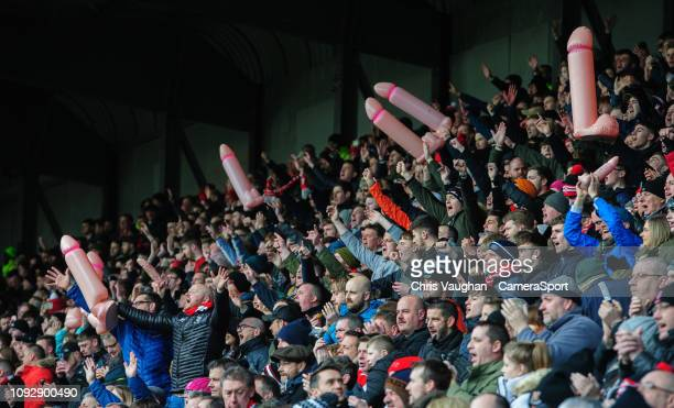 Lincoln City fans hold aloft inflatable penis raising money for Prostate Cancer UK in the wake of Notts County chairman and owner Alan Hardy posting...