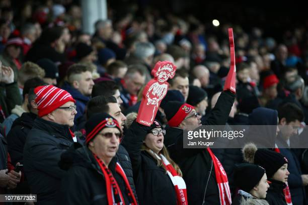 Lincoln City fans show their support as they await kick off prior to the FA Cup Third Round match between Everton and Lincoln City at Goodison Park...