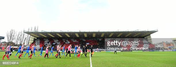 Lincoln City fans with a display prior to the Sky Bet League Two match between Lincoln City and Grimsby Town at Sincil Bank Stadium on March 17 2018...