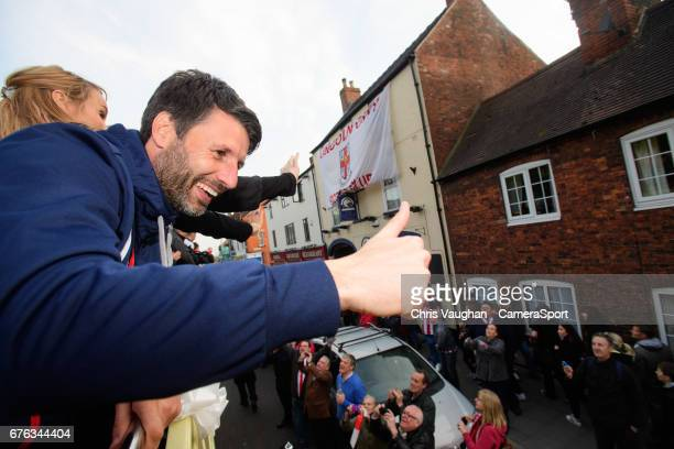 Lincoln City manager Danny Cowley acknowledges the crowd on the High Street during the Lincoln City Open Top Bus Parade to Celebrate Winning the...
