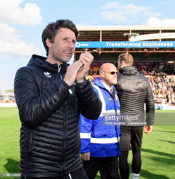 Lincoln City manager Danny Cowley celebrates after securing promotion following the Sky Bet League Two match between Lincoln City and Cheltenham Town...