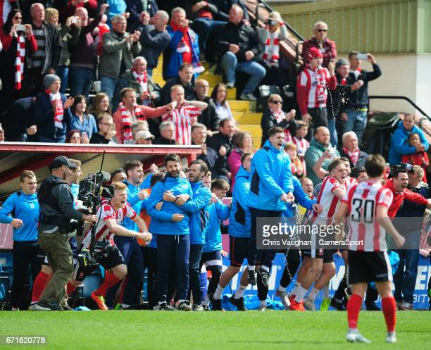 Lincoln City manager Danny Cowley is hugged by Lincoln City's assistant manager Nicky Cowley as the final whistle goes of the Vanarama National...