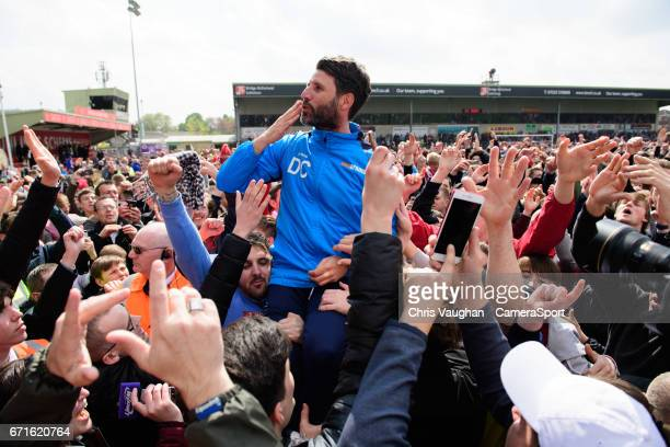 Lincoln City manager Danny Cowley is lifted onto the shoulders of fans at the end of the Vanarama National League match between Lincoln City and...