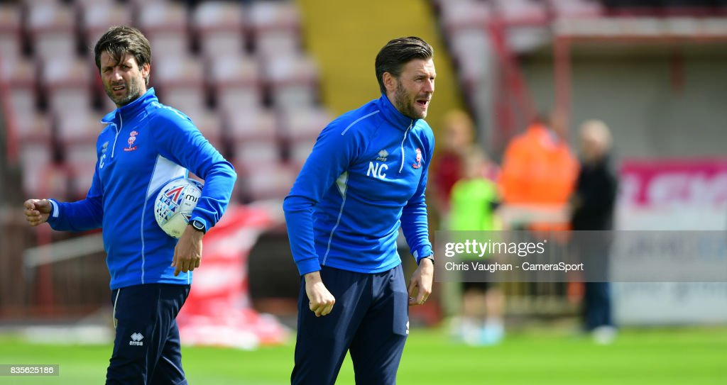 Lincoln City manager Danny Cowley, left, and Lincoln City's assistant manager Nicky Cowley during the pre-match warm-up prior to the Sky Bet League Two match between Exeter City and Lincoln City at St James Park on August 19, 2017 in Exeter, England.
