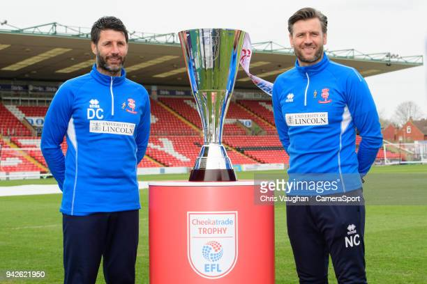 Lincoln City manager Danny Cowley left and Lincoln City's assistant manager Nicky Cowley pose for a photograph with EFL Checkatrade Trophy ahead of...
