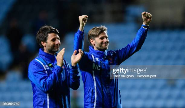 Lincoln City manager Danny Cowley left and Lincoln City's assistant manager Nicky Cowley celebrate at the end of the Sky Bet League Two match between...