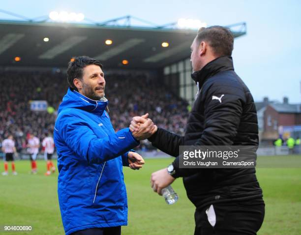 Lincoln City manager Danny Cowley left and Notts County manager Kevin Nolan shake hands prior to the Sky Bet League Two match between Lincoln City...