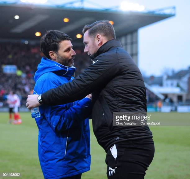 Lincoln City manager Danny Cowley left shakes hands with Notts County manager Kevin Nolan prior to the Sky Bet League Two match between Lincoln City...