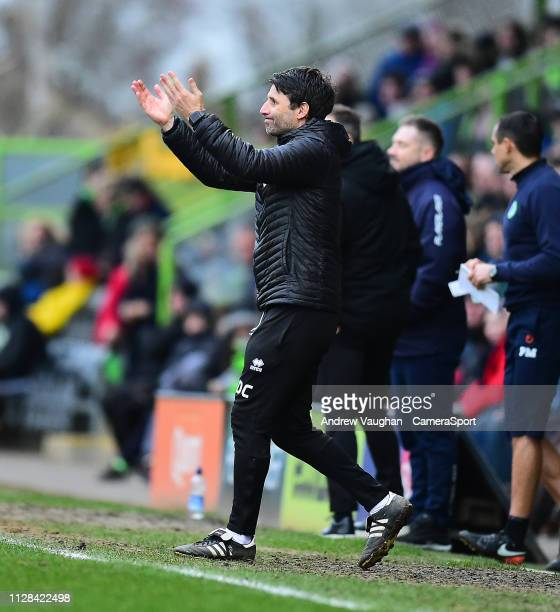 Lincoln City manager Danny Cowley shouts instructions to his team from the technical area during the Sky Bet League Two match between Forest Green...