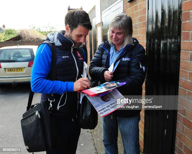 Lincoln City manager Danny Cowley signs an autograph outside the ground during the Sky Bet League Two match between Grimsby Town and Lincoln at...