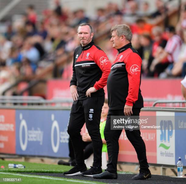 Lincoln City manager Michael Appleton, left, and Lincoln City's assistant manager David Kerslake during the Sky Bet League One match between Lincoln...