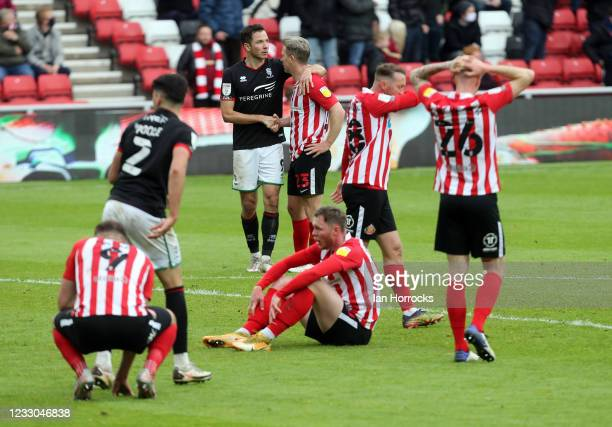 Lincoln City players celebrate on the final whistle during the Sky Bet League One Play-off Semi Final 2nd Leg match between Sunderland and Lincoln...