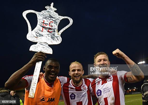 Lincoln City players celebrate their 31 win afterthe Emirates FA Cup Fourth Round match between Lincoln City and Brighton and Hove Albion at Sincil...