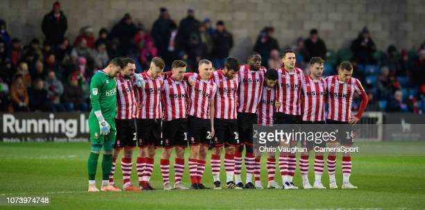 Lincoln City players during a minutes silence as mark of respect to Grace Millane a former University of Lincoln pupil prior to the Sky Bet League...