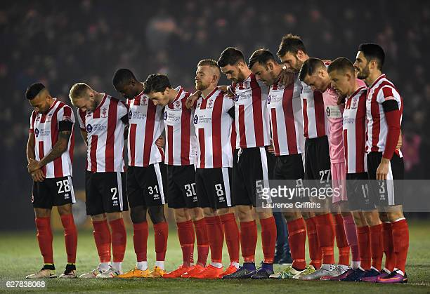 Lincoln City players observe a minutes silence for the victims of the plane crash involving the Brazilian club Chapecoense prior during the Emirates...