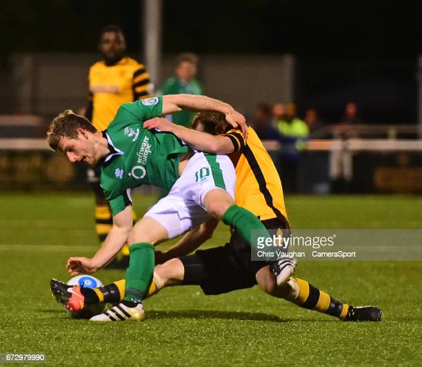 Lincoln City's Adam Marriott vies for possession with Maidstone United's Stuart Lewis during the Vanarama National League match between Maidstone...