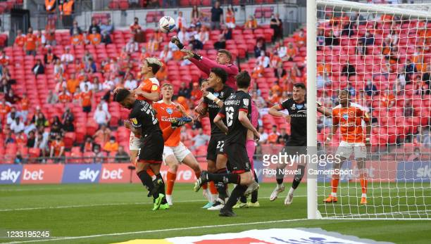 Lincoln City's Alex Palmer punches clear from Blackpool's Kenny Dougall during the Sky Bet League One Play-off Final match between Blackpool and...