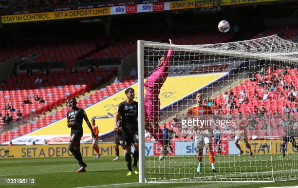 Lincoln City's Alex Palmer sees Blackpool's Demi Mitchell go over the bar during the Sky Bet League One Play-off Final match between Blackpool and...