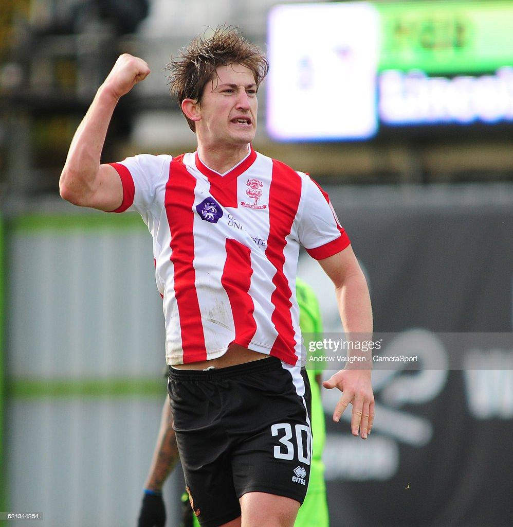 Lincoln City's Alex Woodyard celebrates scoring the opening goal during the Vanarama National League match between Forest Green Rovers and Lincoln City at on November 19, 2016 in Nailsworth, England.
