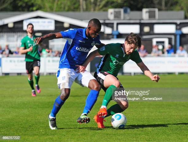 Lincoln City's Alex Woodyard vies for possession with Eastleigh's Hakeem Odoffin during the Vanarama National League match between Eastleigh and...
