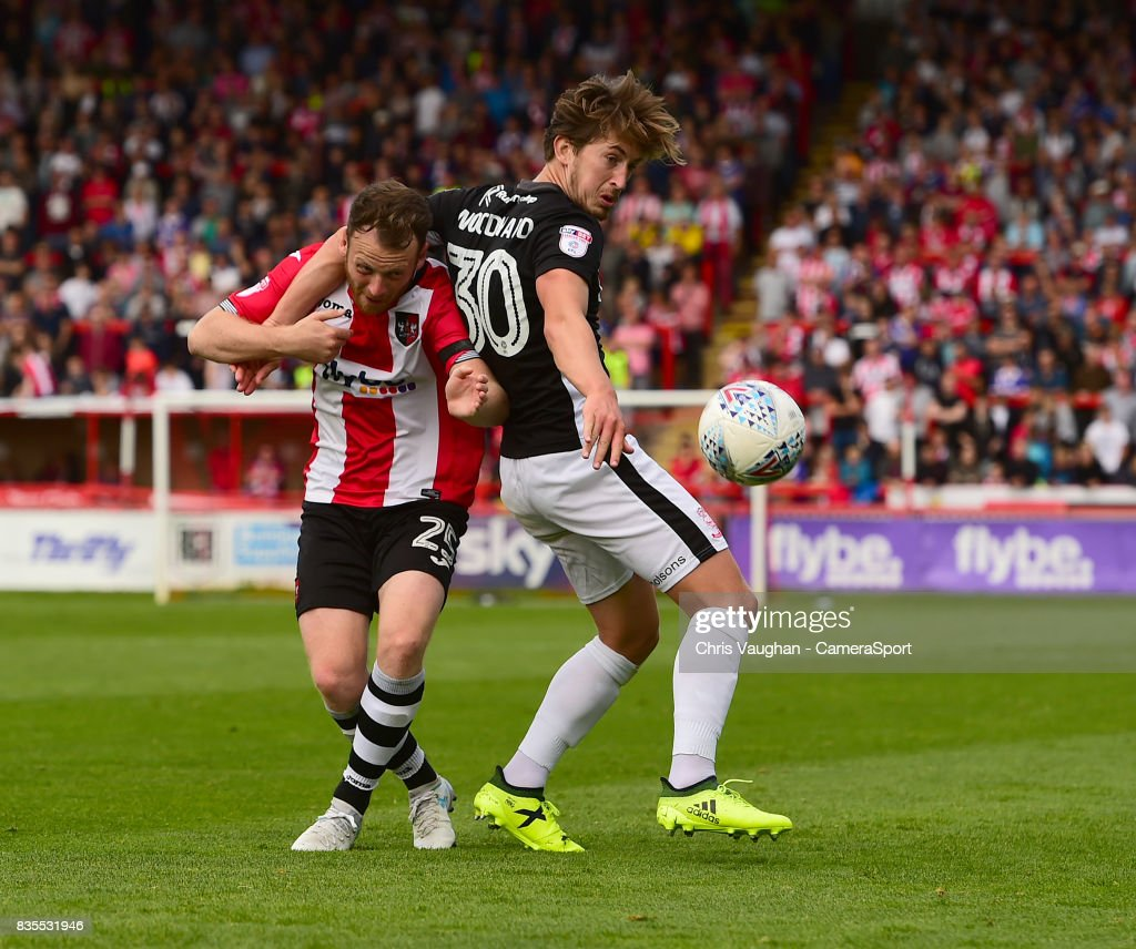 Lincoln City's Alex Woodyard vies for possession with Exeter City's Jake Taylor during the Sky Bet League Two match between Exeter City and Lincoln City at St James Park on August 19, 2017 in Exeter, England.