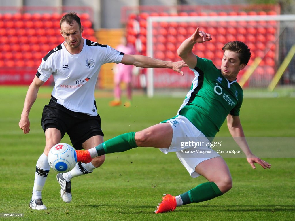 Lincoln City's Alex Woodyard vies for possession with Gateshead's Wes York during the Vanarama National League match between Gateshead and Lincoln City at on April 17, 2017 in Gateshead, England.