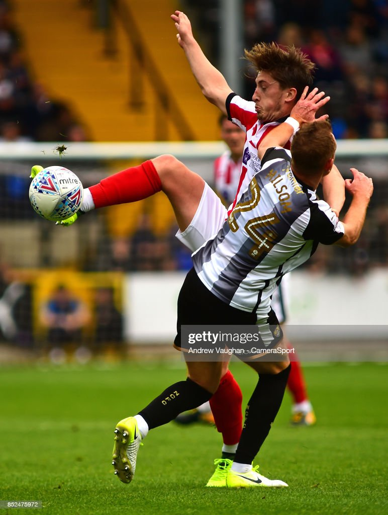 Lincoln City's Alex Woodyard vies for possession with Notts County's Robert Milsom during the Sky Bet League Two match between Notts County and Lincoln City at Meadow Lane on September 23, 2017 in Nottingham, England.