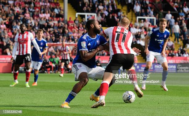 Lincoln City's Anthony Scully is tackled by Ipswich Town's Janoi Donacien, but his appeals for a penalty were turned down, during the Sky Bet League...