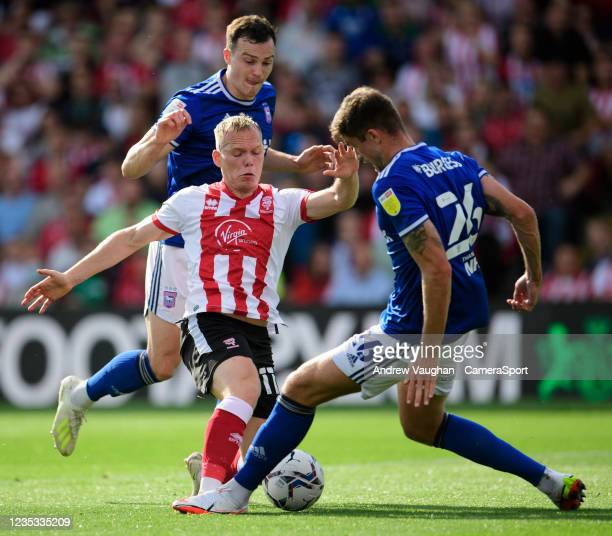 Lincoln City's Anthony Scully vies for possession with Ipswich Town's Cameron Burgess during the Sky Bet League One match between Lincoln City and...