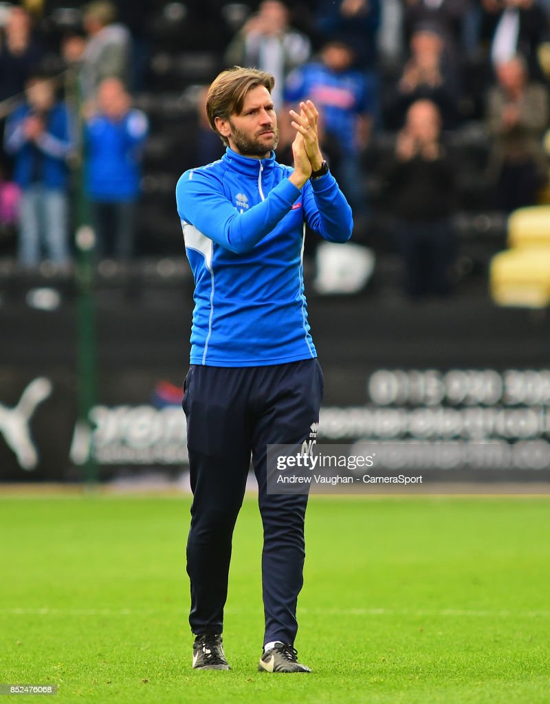 Lincoln City's assistant manager Nicky Cowley applauds the fans at the final whistle following the Sky Bet League Two match between Notts County and Lincoln City at Meadow Lane on September 23, 2017 in Nottingham, England.