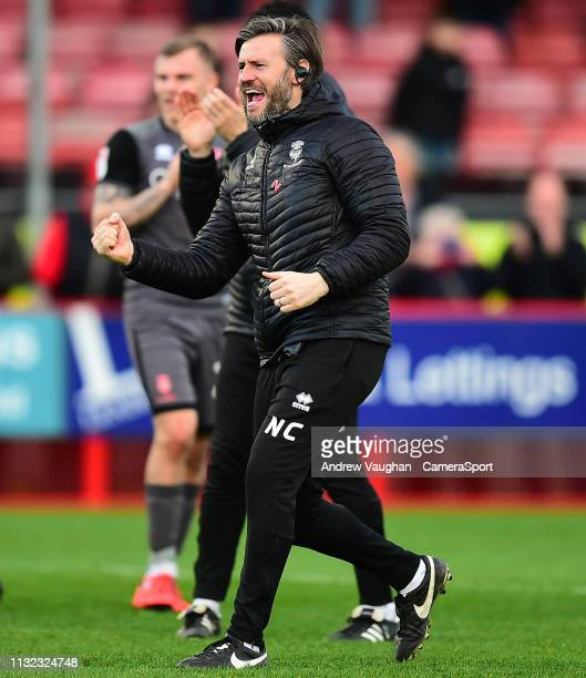 Lincoln City's assistant manager Nicky Cowley celebrates the win with his trademark fist pump following the Sky Bet League Two match between Crawley...