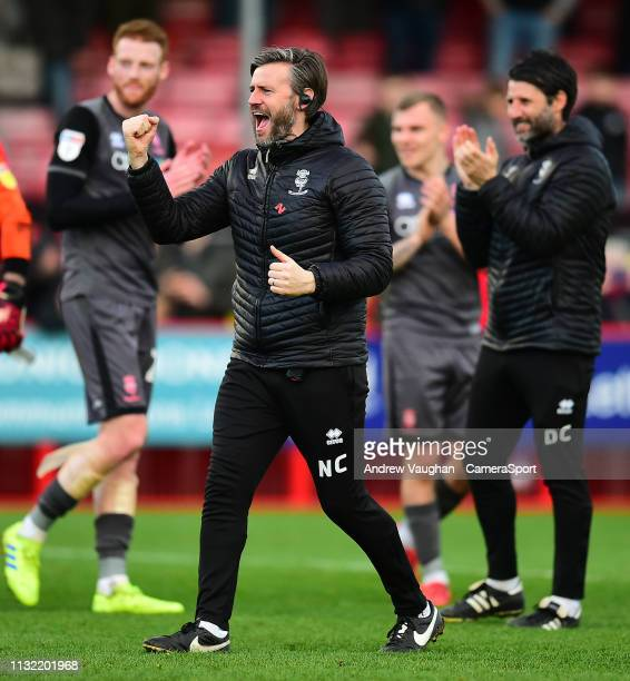 Lincoln City's assistant manager Nicky Cowley gives his traditional fist pump celebration to the fans following the Sky Bet League Two match between...