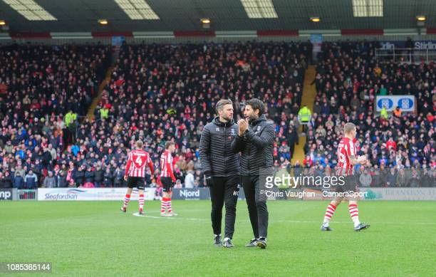 Lincoln City's assistant manager Nicky Cowley left and Lincoln City manager Danny Cowley prior to the Sky Bet League Two match between Lincoln City...
