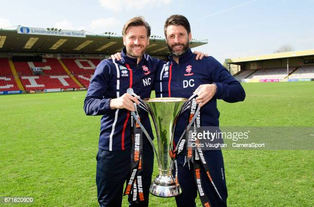 Lincoln City's assistant manager Nicky Cowley left and Lincoln City manager Danny Cowley pose for photographs with the Vanarama National League...