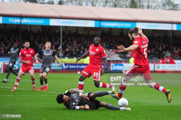 Lincoln City's Bruno Andrade battles with Crawley Town's Joe McNerney during the Sky Bet League Two match between Crawley Town and Lincoln City at...